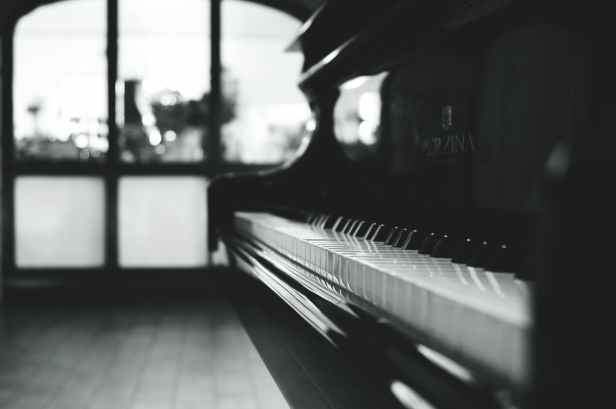 black grand piano gray scale photo