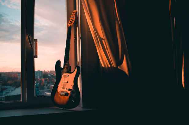 guitar beside window